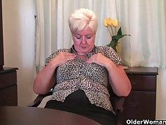 Chunky granny in stockings plays near vibrator