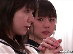 Cute Asian schoolgirls fool around relative to church