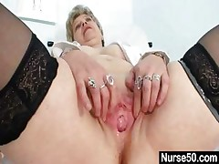 Buxom granny in uniform stretching her aged vagina